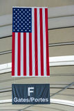 U.S.A Flag in an International Airport. United States flags displayed in an international airport to indicate the entrance to the flights with destination in Royalty Free Stock Photo