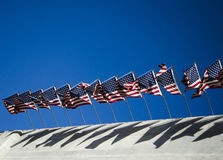 U.S. Flags Waving. Against a blue sky Stock Image