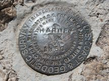 U.S. Geodetic surveying land marker at the top of Harney Peak in Custer State Park in the Black Hills of South Dakota USA stock photos
