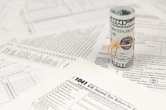 1041 U.S. Income tax return for Estates and Trusts form with roll of american dollar banknotes. Close up. Concept of tax period in United States royalty free stock photo