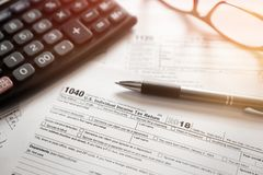 U.S. Individual income tax return. Tax form 1040 with eyeglasses and pen royalty free stock image
