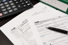 U.S. Individual income tax return. USA tax forms on desk royalty free stock photo