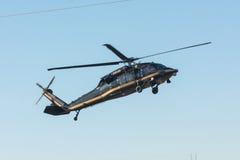U S Las aduanas y la frontera Protetion Sikorsky UH-60A ennegrecen los hel del halcón Imagen de archivo libre de regalías