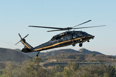 U S Las aduanas y la frontera Protetion Sikorsky UH-60A ennegrecen los hel del halcón Foto de archivo libre de regalías