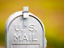 U.S. mailbox. Metallic U.S. mailbox with a nice blurred background and limited depth of field Royalty Free Stock Photography