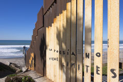 U.S. - Mexico border fence at the beach in Tijuana. Vertical steel girders create the border wall between Mexico and the United States at the beach in Tijuana royalty free stock photo