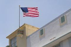 Miami, United States: National Flag waving in Art Deco Building. U.S.A National flag waving flying in the art deco architectural district in daytime Stock Images