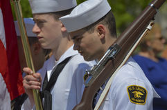 U.S. Naval Cadet Reflects while Marching in Parade. US Naval Cadet reflects while marching in a Fourth of July Parade royalty free stock photo