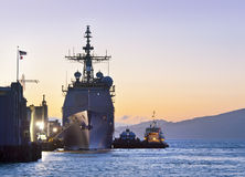 A U.S. Navy Cruiser at Port in San Francisco. A Ticonderage class U.S. Navy Cruiser sits tied to the pier in San Francisco at dusk Stock Photos