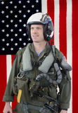 U.S. Navy jet fighter pilot. Navy Jet fighter pilot with an American flag background Stock Images