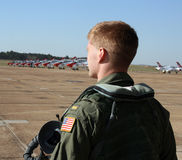 U.S. Navy pilot. Looks over an airfield of jet aircraft Royalty Free Stock Photography