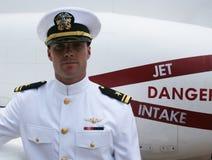 United States Navy Pilot in Dress Whites. U.S. Navy pilot in dress whites uniform in front of his jet royalty free stock images