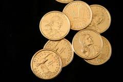U.S. Oro lle monete dell'un dollaro Fotografie Stock