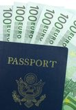 U.S. Passport and 100 Euro. Passport with one hundred Euro banknotes isolated on a white background Royalty Free Stock Photography