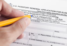 U.S. passport renewal application for eligible individuals. And human hand with ballpoint pen Stock Images