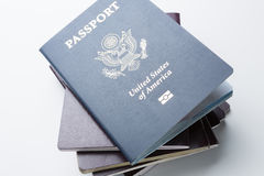 U.S. passport on top of the stack of passports Stock Images