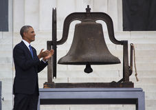 U.S. President Barack Obama. Claps next to Bell from the Birgmingham Church,Alabama, at the Let Freedom Ring ceremony on the steps of the Lincoln Memorial Royalty Free Stock Image