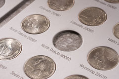 U.S. quarters collection. United States quarter collection in a book Royalty Free Stock Image