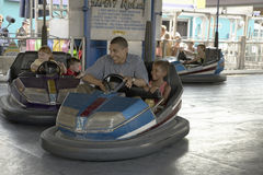 U.S. Senator Barak Obama driving bumper car. With his daughter while campaigning for President at Iowa State Fair in Des Moines Iowa, August 16, 2007 Royalty Free Stock Photos