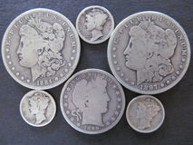 U.S. Silver coin currency lot. U.S. silver coins including Morgan Silver Dollars, Mercury Dimes and a barber half Stock Photos