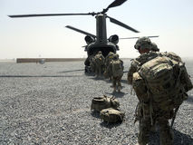 U.S. soldiers getting in an helicopter. This image represents a group of soldiers getting inside a helicopter to get to their mission in Afghanistan Stock Photography
