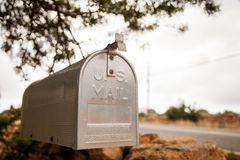 U.S. style metal mailbox photographed in flight perspective with the background blurred royalty free stock photography