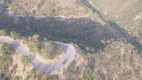 U-shape curve and 4x4 vehicle aerial view at dusk stock video footage
