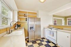 U-shaped kitchen room interior with modern refrigerator Stock Photo