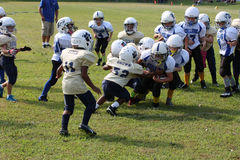 7u Stallions vs Fairdale. Spencer County Stallions runner being tackled by Fairdale Bulldogs player in their game played in Taylorsville Kentucky Royalty Free Stock Photography