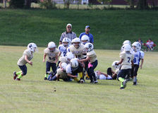 7u Stallions vs Fairdale. Spencer County Stallions runner being tackled by Fairdale Bulldogs player in their game played in Taylorsville Kentucky Stock Photos