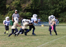 7u Stallions vs Fairdale. Spencer County Stallions runner being tackled by Fairdale Bulldogs player in their game played in Taylorsville Kentucky Royalty Free Stock Photos