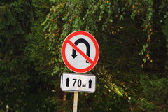 U-Turn forbidden road sign. Road traffic signs in the U-Turn forbidden seventy meters Stock Photos