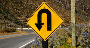 U-turn sign warning caution curve royalty free stock image