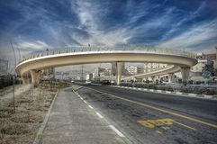 U - turn. A u turn takes me back into my origin bridge in Tehran Iran with a cloudy sky in blue the clouds are amazing and the curve has something to say Stock Photos