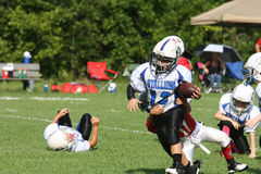 7U youth football  CAL runner Stock Photo