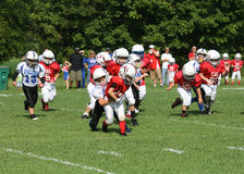 7U youth football  CAL runner Stock Photography