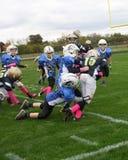 9U youth football gang tackle stock photos