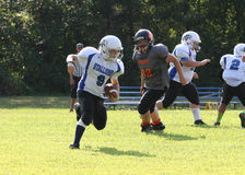 11U youth football runner Royalty Free Stock Images