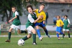 U13 soccer game. KAPOSVAR, HUNGARY - OCTOBER 10: Unidentified soccer players in action at the Hungarian National Championship under 13 game between Kaposvari Stock Photography