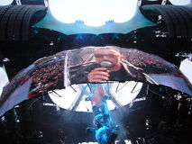 U2 live in Berlin 2009. BERLIN - JULY 18 2009: Bono, famous U2 frontman, sings one of their greatest hits during the European Leg of the U2 360 Tour on July 18 Royalty Free Stock Photo