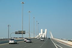 Road traffic in Abu Dhabi, United Arab Emirates. UAE, ABU DHABI, FEBRUARY 4, 2016: Road traffic on Sheikh Zayed bridge in Abu Dhabi - capital and second most stock image