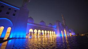 UAE, 2017: Architecture and buildings in the Emirates. UAE symbol. UAE, 2017: Mosque reflected in the water. Evening lights reflected in the water. The interior stock footage
