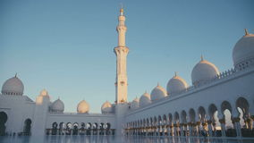 UAE, 2017: Attraction UAE and tourist places. UAE, 2017: The minaret of the main prayer hall and a large white mosque of Sheikh Zayed in Abu Dhabi. Columns and stock footage
