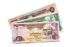UAE Currency. United Arab Emirates dirham banknotes, on white background