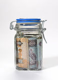 UAE currency in a glass jar. UAE currency in a glass bottle Stock Photography
