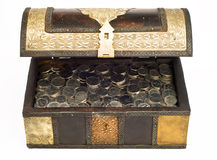 UAE Dirham coins in a trunk_front. An open, antique trunk filled with UAE Dirham Royalty Free Stock Image
