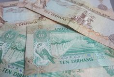 UAE dirham currency notes and coins. Royalty Free Stock Photography