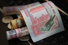 UAE Dirhams banknote. On top of the keyboard stock photo