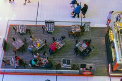 People in a cafe in Dubai Mall shopping center. UAE, DUBAI - DECEMBER 25: people in a cafe in Dubai Mall shopping center on December 25, 2014. Top view Stock Image