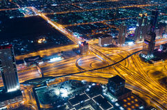 UAE, Dubai, 06/14/2015, downtown dubai futuristic city neon lights and sheik zayed road shot from the worlds tallest tower Stock Image